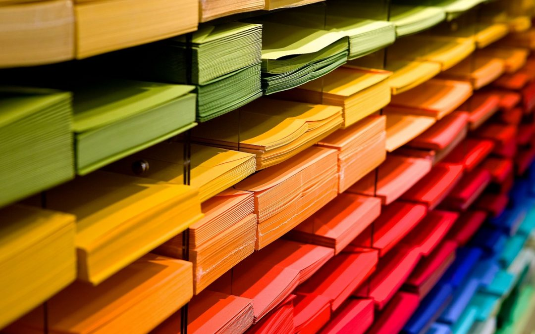 multi-colored-folders-piled-up